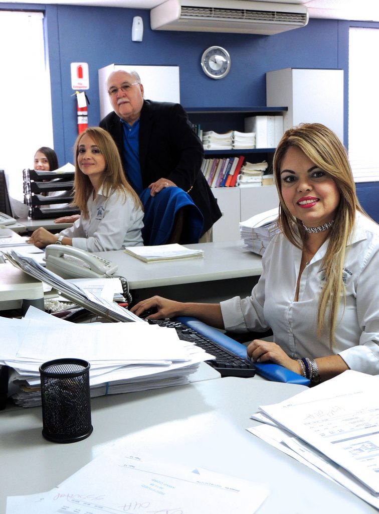 Carlos Rivera, owner of AMAS CORP, with two of his employees at the office