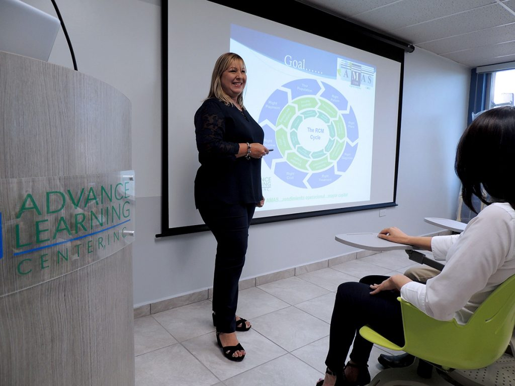 Woman smiling while giving a presentation at the advance learning center
