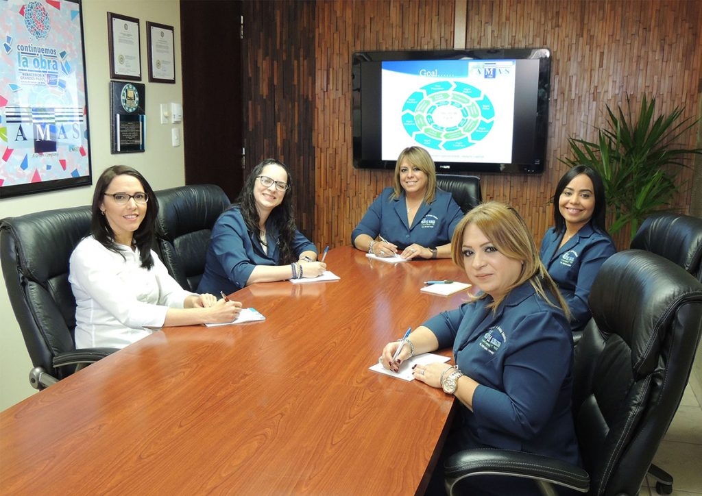 A group of women working in a conference room